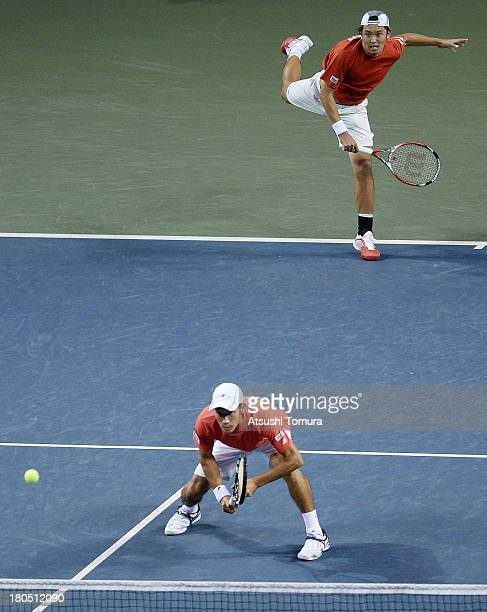 Yuichi Sugita and Tatsuma Ito of Japan serves in the doubles game against Alejandro Falla and JuanSebastian Cabal of Colombia during day two of the...