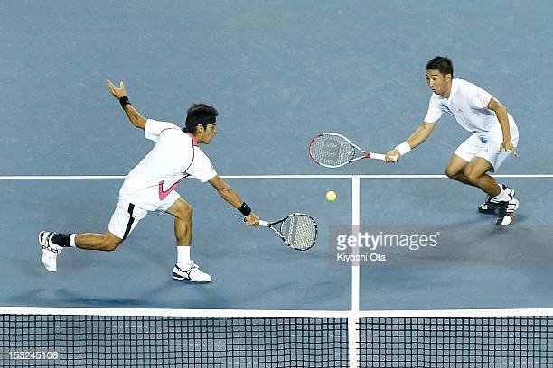 Yuichi Sugita and Yasutaka Uchiyama of Japan play in their first round doubles match against Daniele Bracciali of Italy and Frantisek Cermak of the...