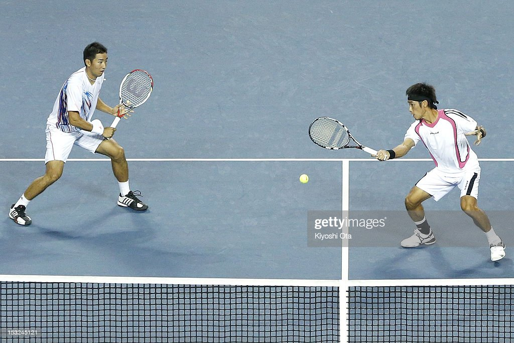 Yuichi Sugita (R) and Yasutaka Uchiyama of Japan play in their first round doubles match against Daniele Bracciali of Italy and Frantisek Cermak of the Czech Republic during day two of the Rakuten Open at Ariake Colosseum on October 2, 2012 in Tokyo, Japan.