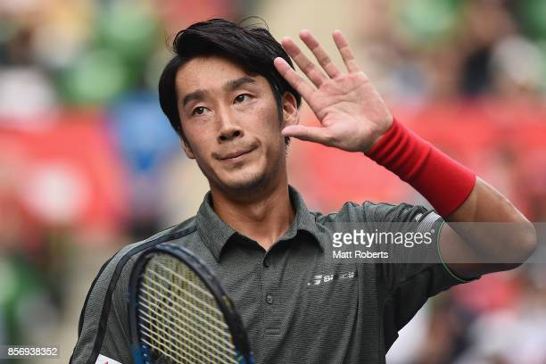 Yuichi Sugita of Japan acknowledges the crowd after his match against Benoit Paire of France during day two of the Rakuten Open at Ariake Coliseum on...