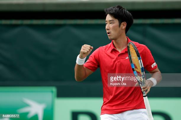 Yuichi Sugita of Japan celebrates a point in his singles match against Thiago Monteiro of Brazil during day four of the Davis Cup World Group Playoff...