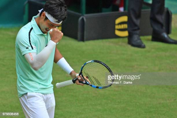 Yuichi Sugita of Japan celebrates after winning his match against Dominic Thiem of Austria during day three of the Gerry Weber Open at Gerry Weber...