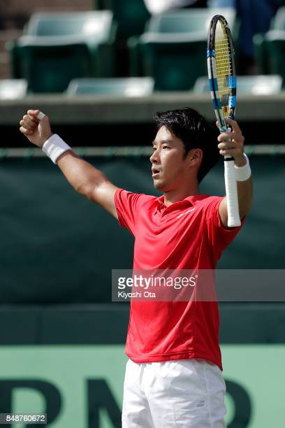 Yuichi Sugita of Japan celebrates after winning his singles match against Thiago Monteiro of Brazil during day four of the Davis Cup World Group...