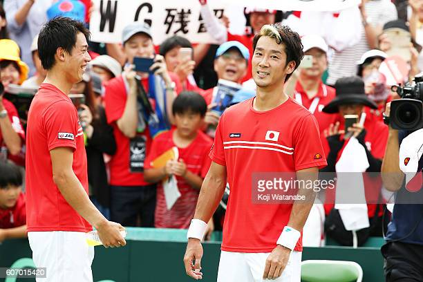 Yuichi Sugita of Japan celebrates the winner with teammate during the Davis Cup World Group Playoff doubles match between at Utsubo Tennis Center on...