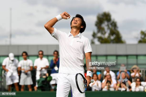 Yuichi Sugita of Japan celebrates victory after the Gentlemen's Singles first round match against Brydan Klein of Great Britain on day two of the...