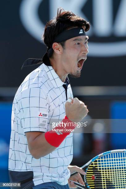 Yuichi Sugita of Japan celebrates winning a point in his first round match against Jack Sock of the United States on day one of the 2018 Australian...
