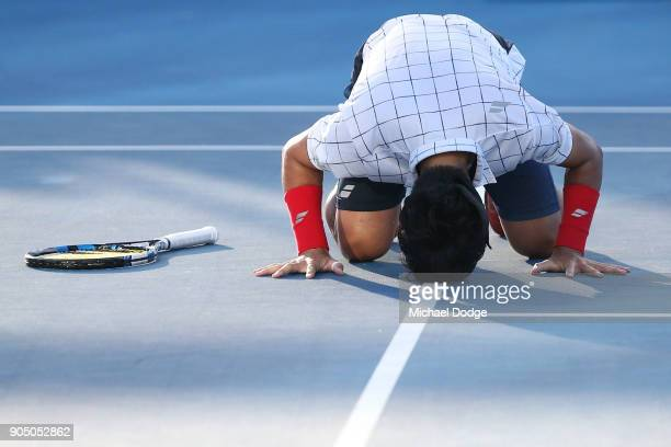 Yuichi Sugita of Japan celebrates winning his first round match against Jack Sock of the United States on day one of the 2018 Australian Open at...