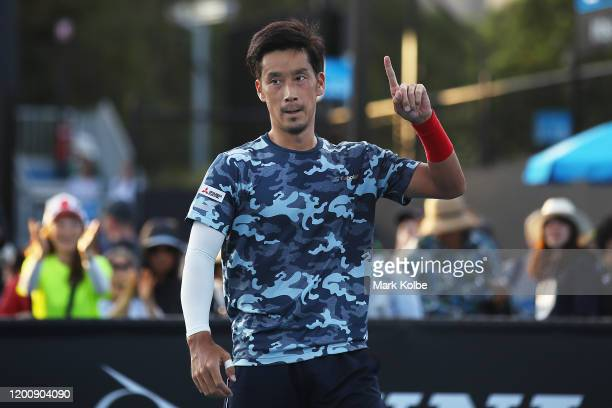 Yuichi Sugita of Japan celebrates winning match point during his Men's Singles first round match against Elliot Benchetrit of France on day two of...