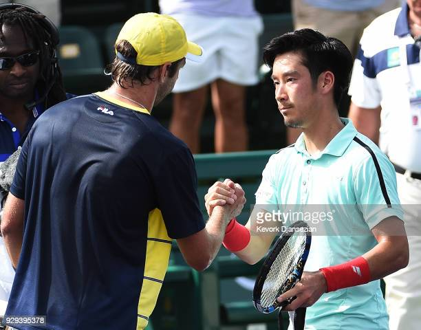 Yuichi Sugita of Japan congratulates Horacio Zeballos of Argentina after his first round exit during Day 4 of the BNP Paribas Open on March 8 2018 in...