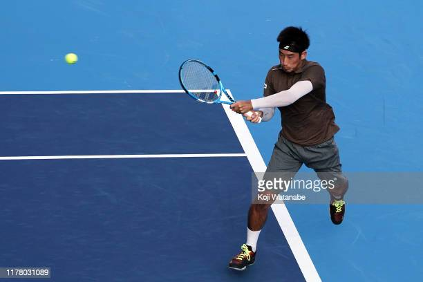 Yuichi Sugita of Japan hits a return shot against Marin Cilic of Croatia on day one of the Rakuten Open at the Ariake Coliseum on September 30 2019...
