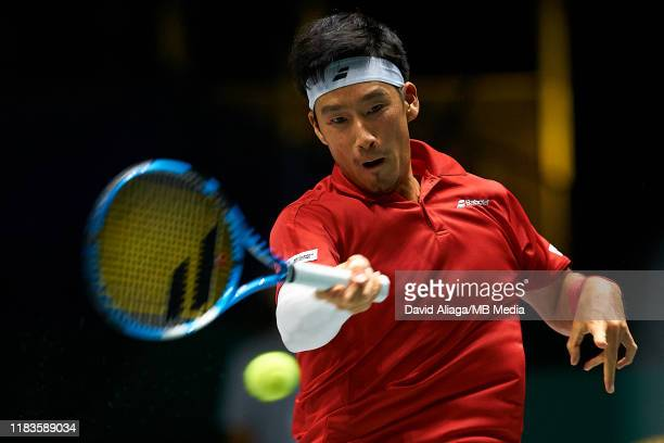 Yuichi Sugita of Japan in action during his match against Filip Krajinovic of Serbia during Day Three of the 2019 Davis Cup at La Caja Magica on...