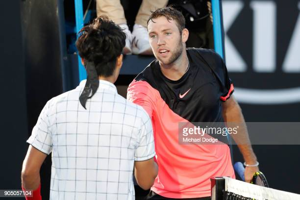 Yuichi Sugita of Japan is congratulated by Jack Sock of the United States after winning his first round match on day one of the 2018 Australian Open...