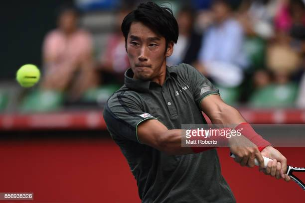Yuichi Sugita of Japan plays a backhand against Benoit Paire of France during day two of the Rakuten Open at Ariake Coliseum on October 3 2017 in...