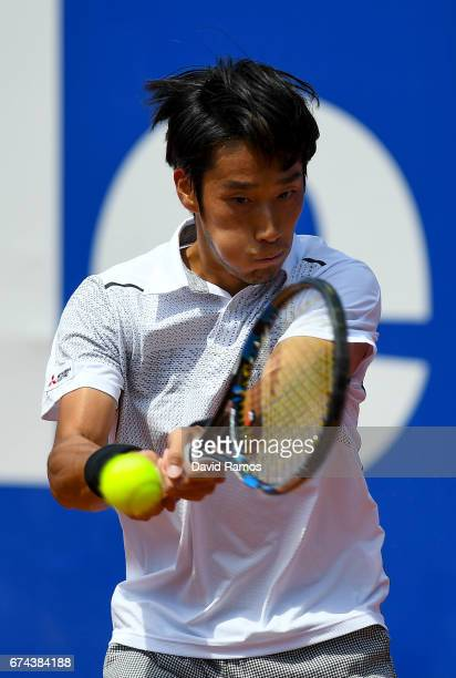 Yuichi Sugita of Japan plays a backhand against Dominic Thiem of Austria on day five of the Barcelona Open Banc Sabadell in the quarterfinal on day...