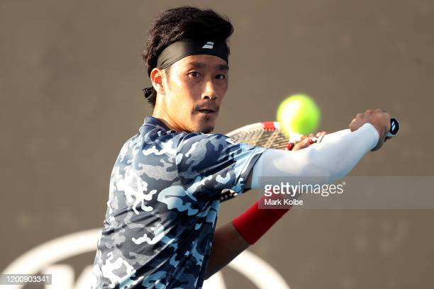 Yuichi Sugita of Japan plays a backhand during his Men's Singles first round match against Elliot Benchetrit of France on day two of the 2020...