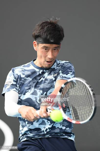 Yuichi Sugita of Japan plays a backhand during his Men's Singles second round match against Andrey Rublev of Russia on day four of the 2020...