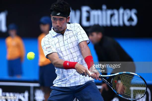 Yuichi Sugita of Japan plays a backhand in his 2018 Hopman Cup match against Roger Federer of Switzerland at Perth Arena on December 30 2017 in Perth...