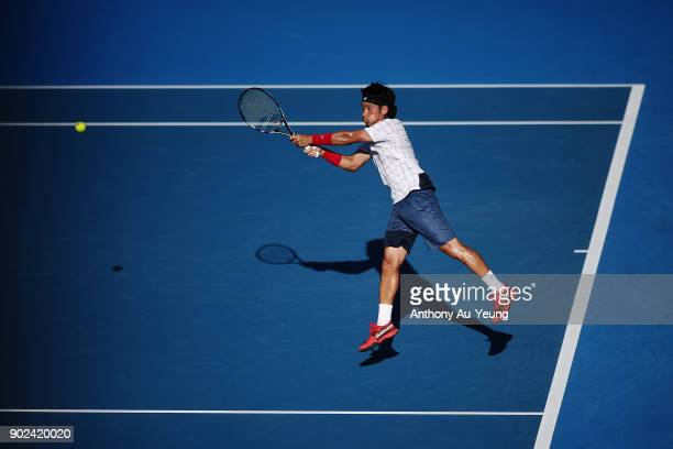 Yuichi Sugita of Japan plays a backhand in his first round match against Karen Khachanov of Russia during day one of the ASB Men's Classic at ASB...