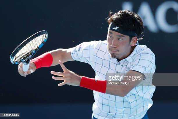 Yuichi Sugita of Japan plays a backhand in his first round match against Jack Sock of the United States on day one of the 2018 Australian Open at...