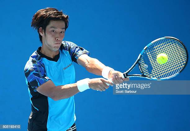 Yuichi Sugita of Japan plays a backhand in his match against Dennis Novikov of the United States during the third round of 2016 Australian Open...