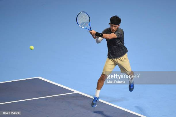 Yuichi Sugita of Japan plays a backhand in his match against Kei Nishikori of Japan on day one of the Rakuten Open at Musashino Forest Sports Plaza...
