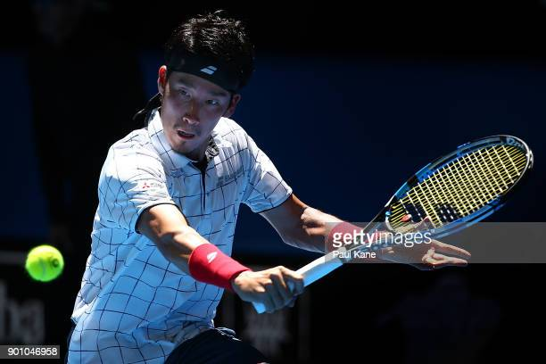 Yuichi Sugita of Japan plays a backhand in his singles match against Karen Khachanov of Russia on day six of the 2018 Hopman Cup at Perth Arena on...
