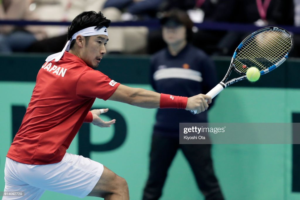Yuichi Sugita of Japan plays a backhand in his singles match against Fabio Fognini of Italy during day three of the Davis Cup World Group first round between Japan and Italy at Morioka Takaya Arena on February 4, 2018 in Morioka, Iwate, Japan.
