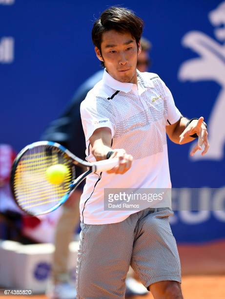 Yuichi Sugita of Japan plays a forehand against Dominic Thiem of Austria on day five of the Barcelona Open Banc Sabadell in the quarterfinal on day...