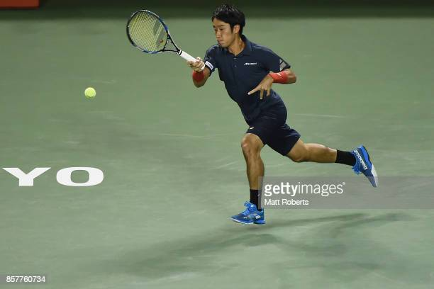 Yuichi Sugita of Japan plays a forehand against Milos Raonic of Canada during day four of the Rakuten Open at Ariake Coliseum on October 5 2017 in...