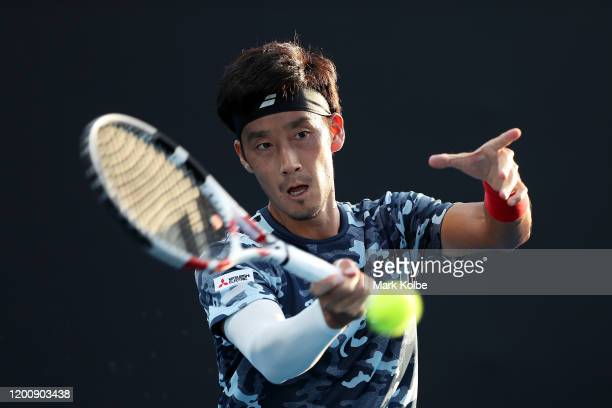 Yuichi Sugita of Japan plays a forehand during his Men's Singles first round match against Elliot Benchetrit of France on day two of the 2020...