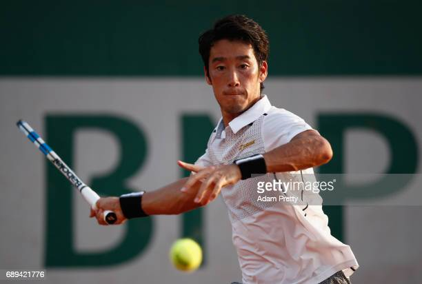 Yuichi Sugita of Japan plays a forehand during the mens singles first round match against Steve Johnson of The United States on day one of the 2017...