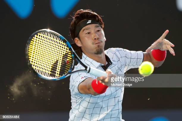 Yuichi Sugita of Japan plays a forehand in his first round match against Jack Sock of the United States on day one of the 2018 Australian Open at...