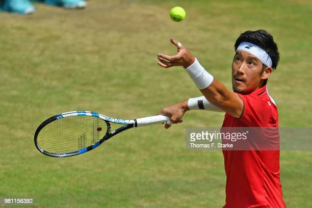 Yuichi Sugita of Japan plays a forehand in his match against Denis Kudla of the United States during day five of the Gerry Weber Open at Gerry Weber...