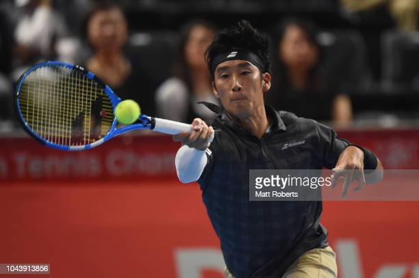 Yuichi Sugita of Japan plays a forehand in his match against Kei Nishikori of Japan on day one of the Rakuten Open at Musashino Forest Sports Plaza...