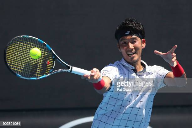 Yuichi Sugita of Japan plays a forehand in his second round match against Ivo Karlovic of Croatia on day three of the 2018 Australian Open at...