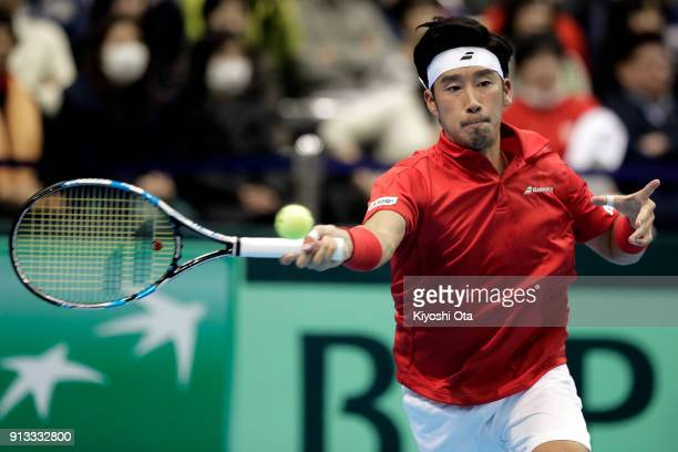 Yuichi Sugita of Japan plays a forehand in his singles match against Andreas Seppi of Italy during day one of the Davis Cup World Group first round...