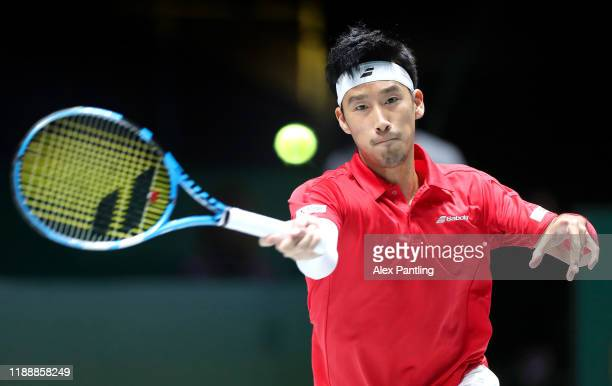 Yuichi Sugita of Japan plays a forehand shot during his Davis Cup Group Stage match against Filip Krajinovic of Serbia during Day Three of the 2019...