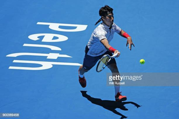 Yuichi Sugita of Japan plays a forehand to Jack Sock of the United States in the mens singles match on Day Four of the 2018 Hopman Cup at Perth Arena...