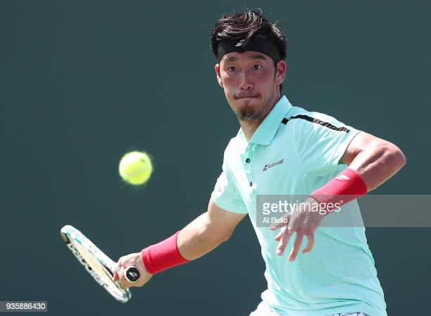 Yuichi Sugita of Japan plays a shot against Robin Haase of the Netherlands during Day 3 of the Miami Open at the Crandon Park Tennis Center on March...