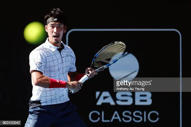 Yuichi Sugita of Japan plays a shot in his first round match against Karen Khachanov of Russia during day one of the ASB Men's Classic at ASB Tennis...