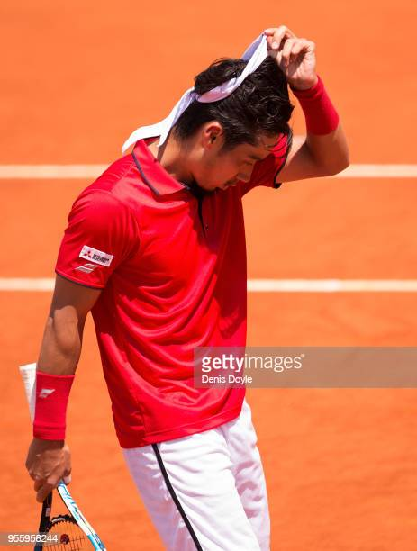 Yuichi Sugita of Japan reacts after losing in straight sets to Philipp Kohlschreiber of Germany during day four of the Mutua Madrid Open tennis...