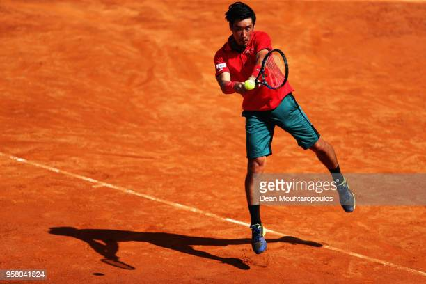 Yuichi Sugita of Japan returns a backhand in his match against Ryan Harrison of the USA during day one of the Internazionali BNL d'Italia 2018 tennis...