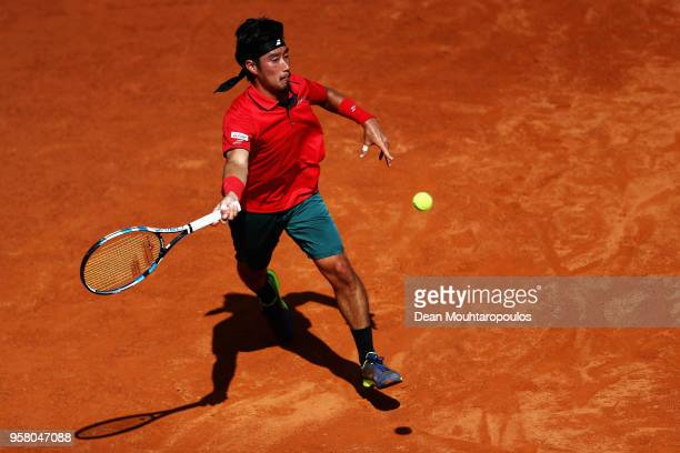 Yuichi Sugita of Japan returns a forehand in his match against Ryan Harrison of the USA during day one of the Internazionali BNL d'Italia 2018 tennis...