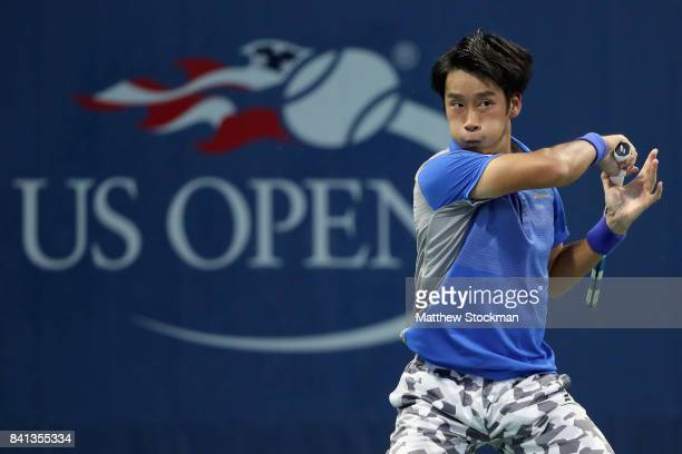 Yuichi Sugita of Japan returns a shot against Leonardo Mayer of Argentina during their second round Men's Singles match on Day Four of the 2017 US...