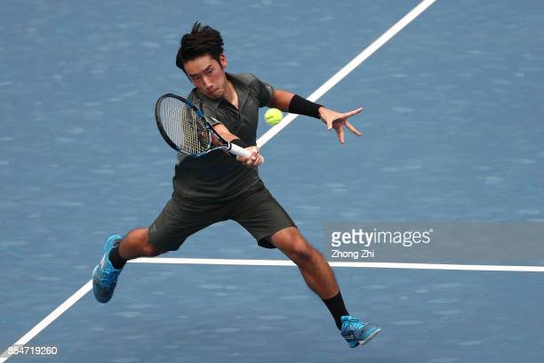 Yuichi Sugita of Japan returns a shot during the match against Thiago Monteiro of Brazil during Day 3 of 2017 ATP Chengdu Open at Sichuan...