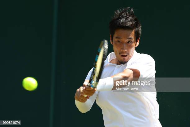 Yuichi Sugita of Japan returns against Bradley Klahn of the United States during their Men's Singles first round match on day two of the Wimbledon...