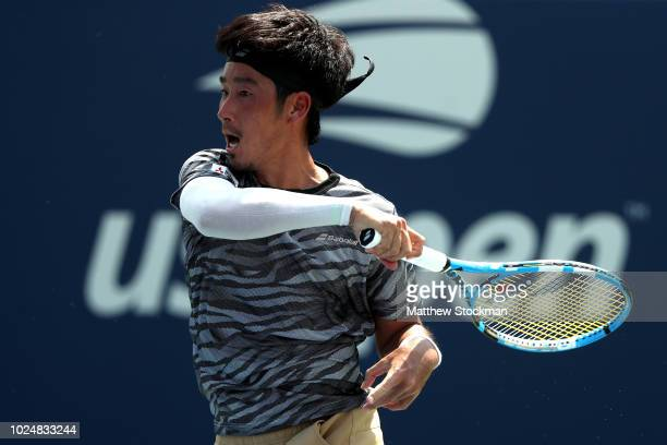 Yuichi Sugita of Japan returns the ball during his men's singles first round match against Richard Gasquet of France on Day Two of the 2018 US Open...