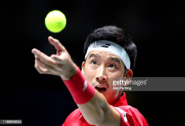 Yuichi Sugita of Japan serves during his Davis Cup Group Stage match against Filip Krajinovic of Serbia during Day Three of the 2019 Davis Cup at La...