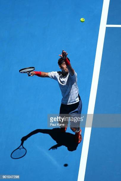 Yuichi Sugita of Japan serves in his singles match against Karen Khachanov of Russia on day six of the 2018 Hopman Cup at Perth Arena on January 4...