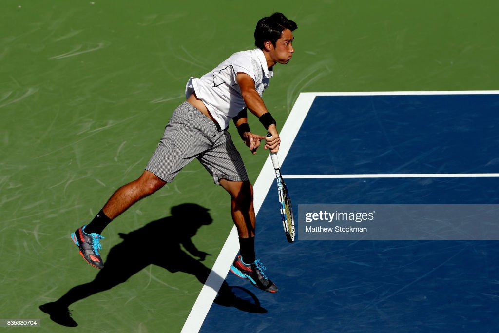 Yuichi Sugita of Japan serves to Grigor Dimitrov of Bulgaria during day 7 of the Western & Southern Open at the Lindner Family Tennis Center on August 18, 2017 in Mason, Ohio.